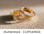 gold wedding rings with shadows | Shutterstock . vector #1129164026
