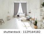 spacious stylish white loft...   Shutterstock . vector #1129164182