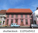 Small photo of JAKARTA, INDONESIA - July 7, 2018: Toko Merah (The Red Shop), a Dutch Colonial old building on Kali Besar, Kota Tua.