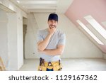 young thinking handyman with... | Shutterstock . vector #1129167362