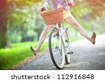 woman riding bicycle with her... | Shutterstock . vector #112916848