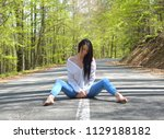 sexy woman sitting on the road | Shutterstock . vector #1129188182