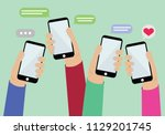 many hand holding mobile show... | Shutterstock .eps vector #1129201745