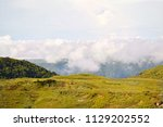 view of cherrapunjee  distant... | Shutterstock . vector #1129202552