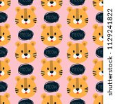 faces of tigers on a pink... | Shutterstock .eps vector #1129241822