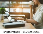 freelancer woman drinking... | Shutterstock . vector #1129258058