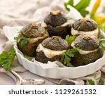 vegetarian stuffed zucchini.... | Shutterstock . vector #1129261532