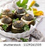 vegetarian stuffed zucchini....   Shutterstock . vector #1129261535