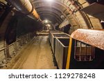 underground mine with railroad... | Shutterstock . vector #1129278248