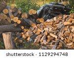 pile of firewood. preparation... | Shutterstock . vector #1129294748