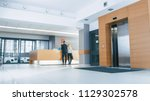 in the hospital lobby young... | Shutterstock . vector #1129302578