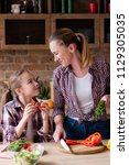 family cooking. mother and... | Shutterstock . vector #1129305035
