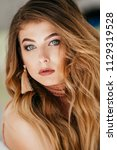 portrait of beautiful young... | Shutterstock . vector #1129319528