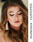 portrait of beautiful young... | Shutterstock . vector #1129319552