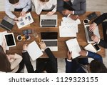 diverse business team at... | Shutterstock . vector #1129323155