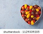fresh delicious tomatoes in... | Shutterstock . vector #1129339205