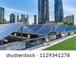 solar and modern city skyline | Shutterstock . vector #1129341278