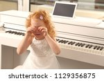 a overwhelmed girl child crying ... | Shutterstock . vector #1129356875