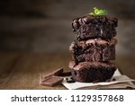 a stack of chocolate brownies... | Shutterstock . vector #1129357868