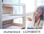 beautiful concentrated lady at...   Shutterstock . vector #1129380575