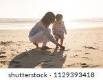 young mother exploring the... | Shutterstock . vector #1129393418