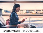 airport phone travel asian... | Shutterstock . vector #1129428638