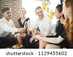 happy young people with... | Shutterstock . vector #1129455602