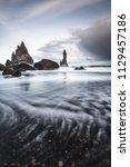 rock formations on a black sand ... | Shutterstock . vector #1129457186