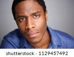 close up portrait of serious... | Shutterstock . vector #1129457492