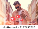 young adult man using social... | Shutterstock . vector #1129458962
