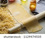 homemade pasta dough is being... | Shutterstock . vector #1129474535