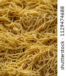 dried egg noodles. raw fresh... | Shutterstock . vector #1129474688