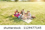 happy families doing picnic in... | Shutterstock . vector #1129477145
