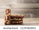 tasty chocolate granola bars on ... | Shutterstock . vector #1129482842
