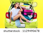 ready to travel. young woman in ... | Shutterstock . vector #1129490678