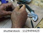 hands work  repair  job | Shutterstock . vector #1129494425