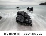 beach rocks at the sango bay... | Shutterstock . vector #1129503302