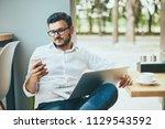 handsome young man wearing... | Shutterstock . vector #1129543592
