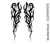 tribal symmetric pattern... | Shutterstock .eps vector #1129547075