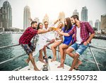 group of friends making party... | Shutterstock . vector #1129550732