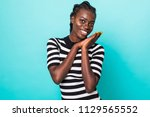 attractive young african... | Shutterstock . vector #1129565552