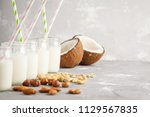 vegan alternative nut milk in... | Shutterstock . vector #1129567835