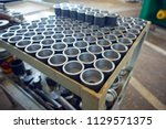metal parts after machining on... | Shutterstock . vector #1129571375