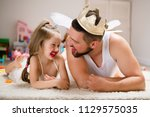 little daughter and father have ... | Shutterstock . vector #1129575035
