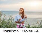 happy beautiful woman blowing...   Shutterstock . vector #1129581068