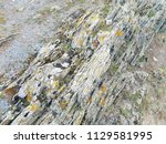 ancient eroded rocks background ... | Shutterstock . vector #1129581995