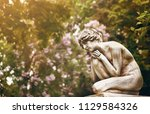 old tombstone memorial statue... | Shutterstock . vector #1129584326