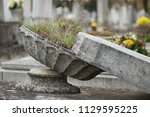 neglected grave with headstone... | Shutterstock . vector #1129595225