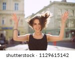 positive brunette woman with... | Shutterstock . vector #1129615142
