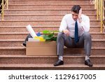 young businessman on the street ... | Shutterstock . vector #1129617005